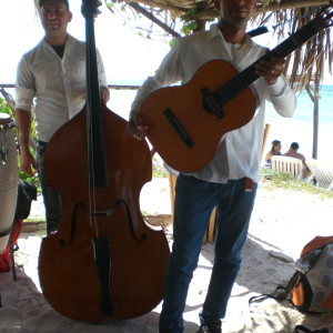 Music whilst you eat BBQ lobster and chill out on a white sand beach in Western Cuba