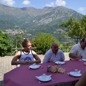 Taking a leisurely local lunch with the foothills of the Alps as a backdrop